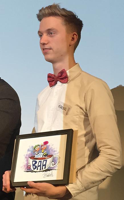 Markus accepts the award